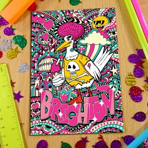 notebook front cover on a table featuring psychedelic drawing of a punk seagull with pink hair, holding an ice cream. Text reads Brighton.
